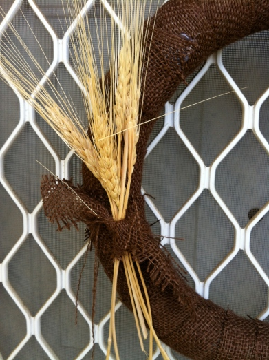 A bundle of wheat to accent the wreath.
